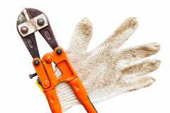 Wrench and gloves on isolated white. Stock Image