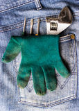 Wrench, gloves and a screwdriver Royalty Free Stock Image