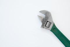 Wrench with green grip handle. On white Stock Photo
