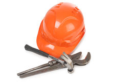 Wrench and hammer whit helmet Stock Image