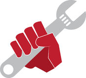 Wrench Hand. Red hand holding a wrench Royalty Free Stock Photography