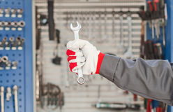 Wrench in hand. stock photo
