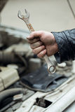 Wrench in hand. Car repair royalty free stock photo