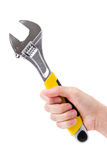 Wrench, hand holding spanner Stock Photos