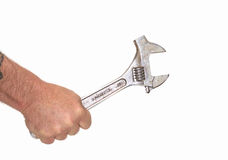 Wrench in Hand isolated on white. A large crescent wrench in a mans hand stock images
