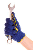 Wrench in hand with protection glove isolated Stock Images