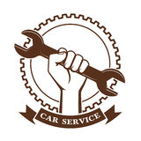 Wrench in a hand a symbol of car service Stock Photography