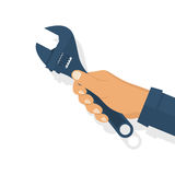 Wrench in hand vector Stock Image