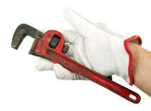 Wrench in hand with work glove stock photography