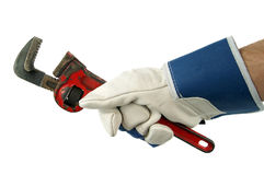 Wrench in hand with work glove Stock Photos