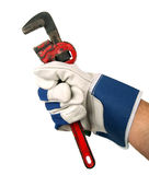 Wrench in hand with work glove Royalty Free Stock Image