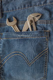 Wrench in jean. Engineer pocket Royalty Free Stock Photo