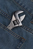 Wrench in jean pocket Royalty Free Stock Photography