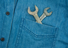 Wrench in jean pocket. Royalty Free Stock Image