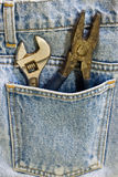 Wrench and jeans Stock Image