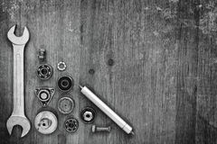 Wrench and machine parts Royalty Free Stock Images