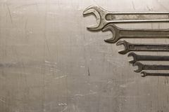 The wrench on the metal sheet Royalty Free Stock Image