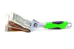 Wrench with money on a white Stock Photography