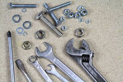 Wrench, monkey wrench and various bolts and nuts Stock Photos