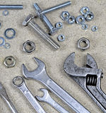 Wrench, monkey wrench and various bolts and nuts Royalty Free Stock Images