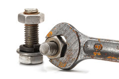 WRENCH WITH A NUT Royalty Free Stock Photography