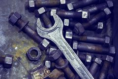 Wrench and nut.Industrial tools. Photo tinted. Royalty Free Stock Image