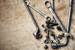 Wrench with nuts and bolt. Space for text. Royalty Free Stock Photo