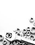 Wrench on nuts and bolts. On White background Stock Images