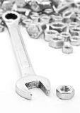 Wrench on nuts and bolts. On White background Royalty Free Stock Photo