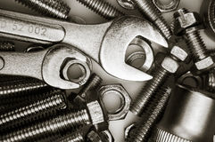 Wrench on nuts and bolts Stock Image