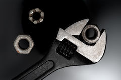 Wrench and nuts Stock Images