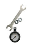 Wrench, nuts, manometer, isolated. On white Royalty Free Stock Image