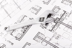 Wrench nuts and plans. Plumbing Equipment On House Plans Stock Images