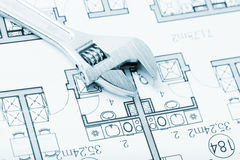 Wrench and plans. Plumbing Equipment On House Plans Royalty Free Illustration
