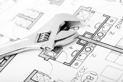 Wrench and plans. Plumbing Equipment On House Plans Stock Images