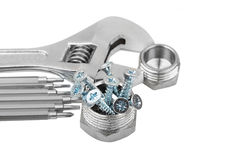 Wrench, plumbing fitting and screw Stock Images