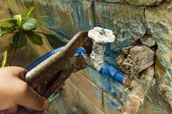Wrench in the plumbing hand - repair of a water tap royalty free stock photos