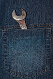 Wrench in pocket. This is wrench in pocket of fabric jeans. It is theme of tools Royalty Free Stock Image