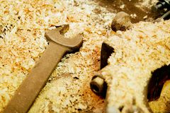 Wrench in sawdust Royalty Free Stock Photography