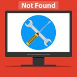A wrench and a screwdriver on the computer screen. Page error Royalty Free Stock Photography