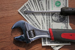 Wrench, screwdriver and dollars Royalty Free Stock Images