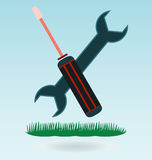 Wrench and screwdriver icon. Grass concept royalty free illustration