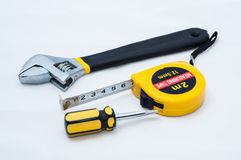 Wrench screwdriver and measuring tape Royalty Free Stock Images