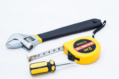 Wrench screwdriver and measuring tape Stock Photo