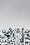 Wrench with screwdriver, screws and bolts of different size  Stock Image