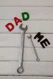 Wrench, screwdriver with text dad and me. On wooden plank Royalty Free Stock Photography