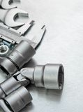Wrench with a set of heads and other tools on the Stock Photo