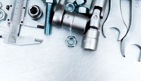 Wrench with a set of heads and other tools on the Royalty Free Stock Photography