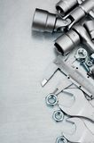 Wrench with a set of heads and other tools on the Royalty Free Stock Image