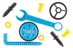 Wrench, steering wheel, wheel, bolts and nuts as parts of childrens educational plastic  designer Royalty Free Stock Photo
